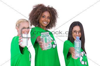 Three smiling enviromental showing matierials