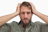 Exhausted man with hands on head