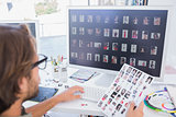 Photo editor working on the contact sheet