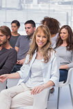 Woman smiling at camera in group therapy
