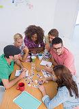 Editors choosing photographs in a meeting