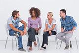 Stylish people sitting and chatting