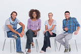 Stylish people sitting and smiling at camera