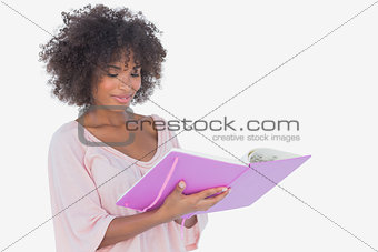 Beautiful woman looking at photo album