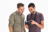 Stylish men looking at digital camera