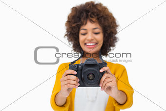 Attractive girl holding a camera
