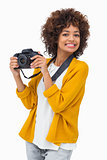 Smiling girl holding digital camera