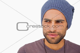 Thoughtful man wearing beanie hat