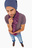 Thinking man wearing beanie hat and scarf