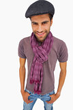 Smiling man wearing peaked cap and scarf