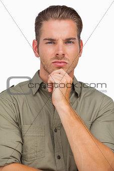 Thoughtful man looking at camera