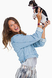 Happy woman lifting her chihuahua