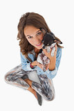 Pretty woman cuddling her chihuahua
