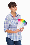 Pretty woman with fringe holding colour charts