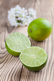 Limes on wooden background