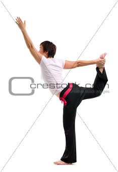 Asian mature woman practicing yoga