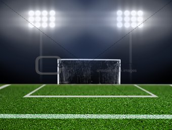 Empty soccer field with spotlights