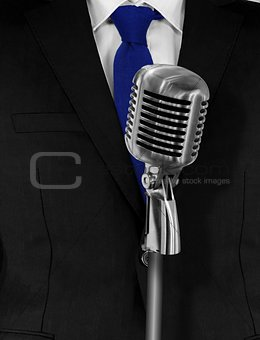 Man in suit with retro microphone