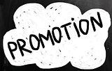 """promotion"" handwritten with white chalk on a blackboard"