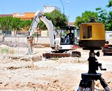 Excavator engaged in excavation of foundation excavation