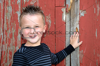 smiling boy by barn