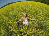 Model In Field Of Flowers