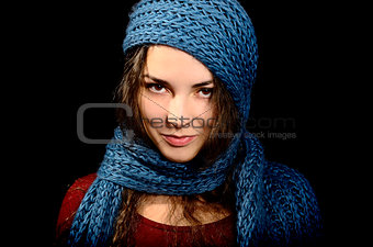 A girl with a blue scarf