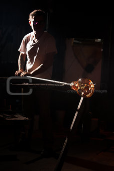 Person Holding Hot Glass Art