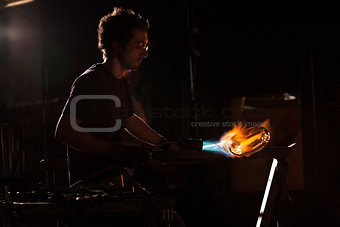 Person Shaping Glass with Blowtorch