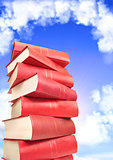 Books on background with blue sky