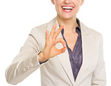 Closeup on smiling business woman showing ok gesture
