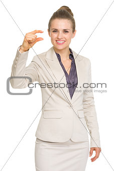 Business woman showing small risk gesture