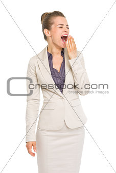 Portrait of business woman yawing