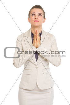 Portrait of business woman praying