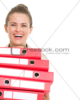 Smiling business woman holding stack of folders