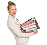 Happy business woman holding stack of folders