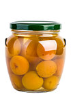 Glass jar with preserved apricots