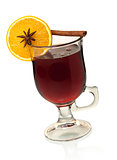 Hot mulled wine with orange slice, anise and cinnamon
