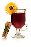 Hot mulled wine with orange slice and cinnamon