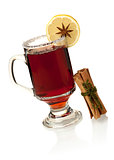 Hot mulled wine with lemon slice and cinnamon