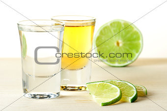 Blanc and Gold Tequila with lime slices
