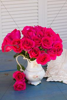 Mauve roses in vase