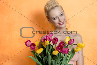 Blonde woman with colourful bouquet