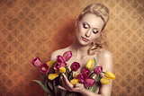Blonde taking colourful bouquet vintage