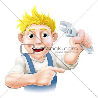 Cartoon plumber or mechanic pointing