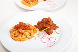 pasta with pork ribbs sauce on polenta bed