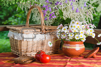 Summer   still life with flowers and food