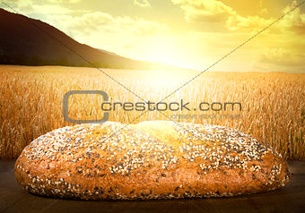 Bread and wheat cereal crops at sunset