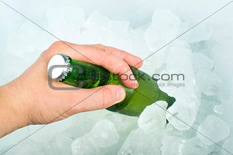 Bottle of beer and ice cubes