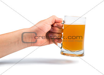 Hand holding bottle of beer and beer mug